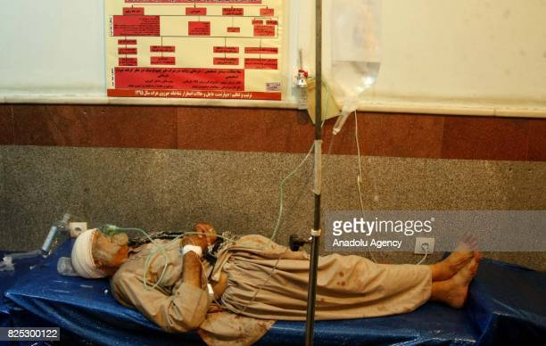 An old man receives medical treatment after suspected suicide bomber struck a Shia mosque in western Herat province Afghanistan on August 1 2017 At...