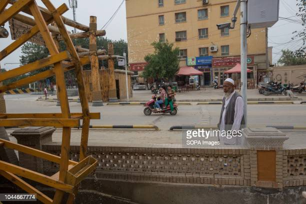 An old man seen walking on the streets of Keriya in the Hotan Prefecture Xinjiang Uyghur Autonomous Region in China Kashgar is located in the north...
