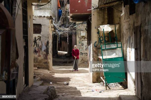 An old man seen walking through the refugee camp located in Tripoli Lebanon host over a million of refugees that had fled from the neighboring...
