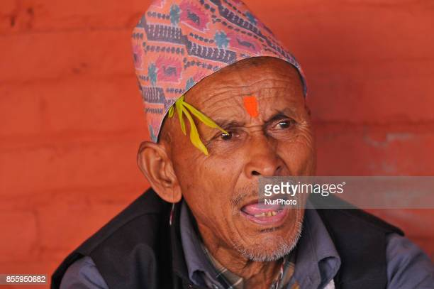 An old man singing ritual songs during the tenth day of Dashain Durga Puja Festival in Bramayani Temple Bhaktapur Nepal on September 30 2017 Dashain...