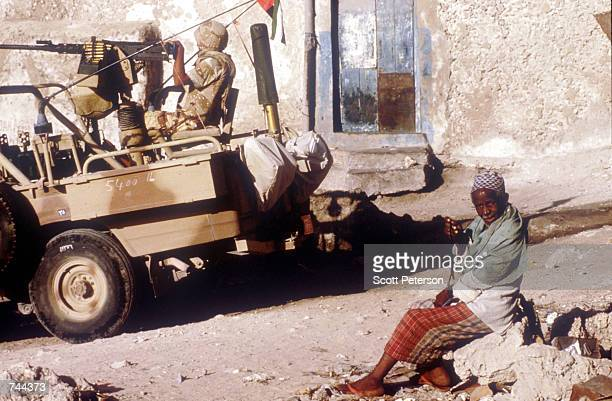 An old man sits next to a jeep with a U.S. Marine on patrol March 3, 1993 on the streets of Mogadishu, Somalia. The U.S. Has been the main pillar in...