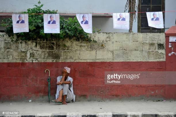 An old man staying on shade to offer greeting towards Former King Gyanendra Shah on his 71th birthday at his residence Nirmal Niwas, Maharjagunj,...