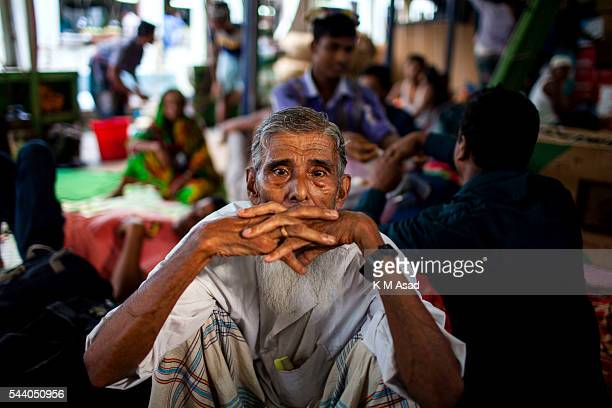 SADARGHAT DHAKA BANGLADESH An old man waits in a boat going to his village Bangladesh is one of the most densely populated countries in the world...