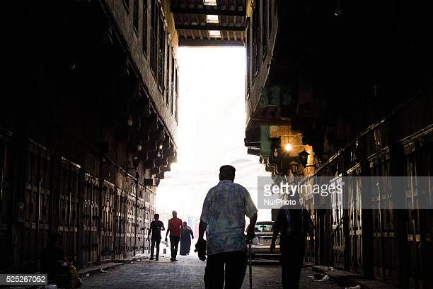 An old man walking in one of the ancient streets in Cairo on the first day of Eid alAdha Cairo on September 24 2015