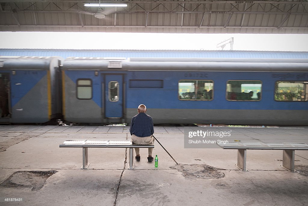 CONTENT] An old man watches the Shatabdi express train carrying his loved ones depart the Chandigarh Railway Station