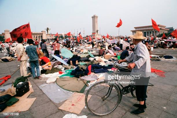 An old man with a bicycle takes a walk in Tiananmen Square to see the protestors for himself Prodemocracy demonstrators and protestors filled the...