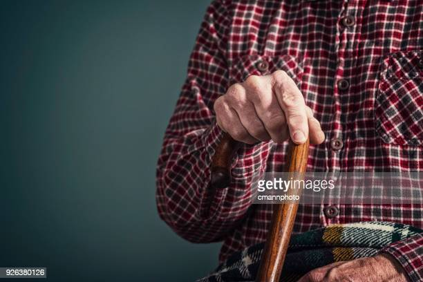 an old man's arthritic hand holding onto a cane - cmannphoto stock pictures, royalty-free photos & images