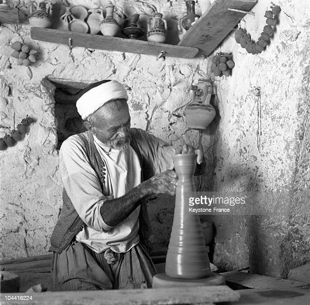 An old member of Djerba's Jewish community practising his craft of pottermaker in Tunisia around 1970 Djerba's Jewish community is one of the oldest...