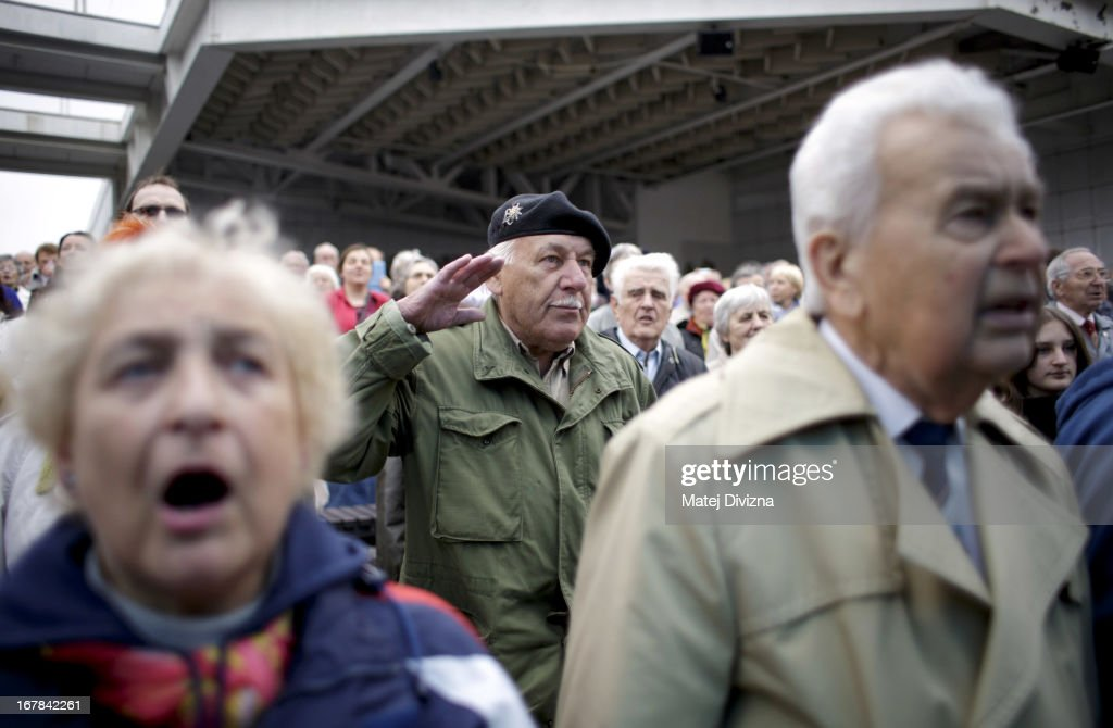 An old member of the Czech opposition Communist (KSCM) party salutes during the popular communist song 'International' during May Day celebration on May 1, 2013 in Prague, Czech Republic. In addition to celebrations across the globe of the beginning of spring throughout the world, workers are gathering in city centers to annually vent their grievances and support their worker's unions.
