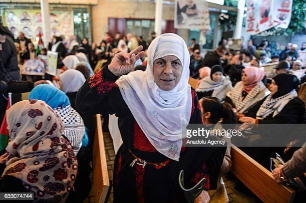 An old Palestinian woman gestures during a a demonstration in support of her relatives held in Israeli prisons in front of the International Red...