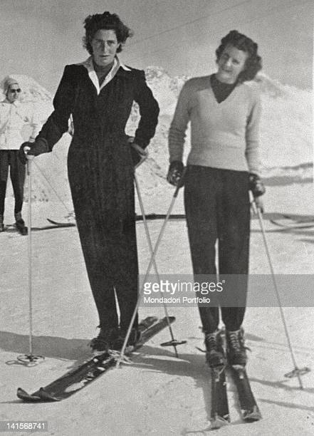An old photo belonged to Susanna Agnelli that portray herself on the skis together with her youngher sister Cristina Agnelli smiling before a descend...
