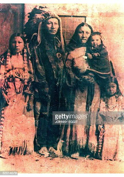 An old photograph showing Chief Long Wolf and his family, taken over 100 years ago, was held by members of the Chief's family, 25 September, as the...
