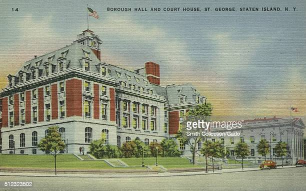 An old postcard picture of the distinctive building of the Borough Hall and Court House a corner view showing two sides of the building green lawn...