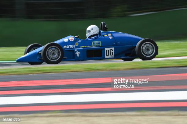 An old race car during Minardi Day in Imola During this demonstration the historic cars of Formula 1 Formula 2 Formula 3 Gran Turismo and Prototipo...