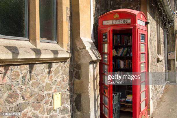 an old red telephone box, used as a community library, malvern, worcestershire, uk. - red telephone box stock pictures, royalty-free photos & images