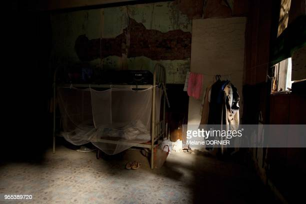 An old rich house of Kuo Min Tang is having last tenants before refurbishment on November 11 a worker's room with his few belongings in Suzhou city...