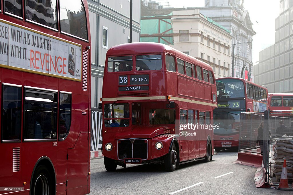 An old Routemaster double-decker bus, which had been decommissioned from regular service, carries commuters from Victoria Station whilst the London Underground runs a limited service due to industrial action on April 30, 2014 in London, England. At 9pm on April 28, 2014 members of the Rail, Maritime and Transport (RMT) Union commenced a 48 hour strike on the London Underground over plans to close all ticket offices with the loss of nearly 1000 jobs.