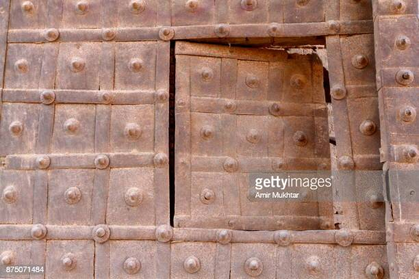 an old rusted gate - bahawalpur stock pictures, royalty-free photos & images