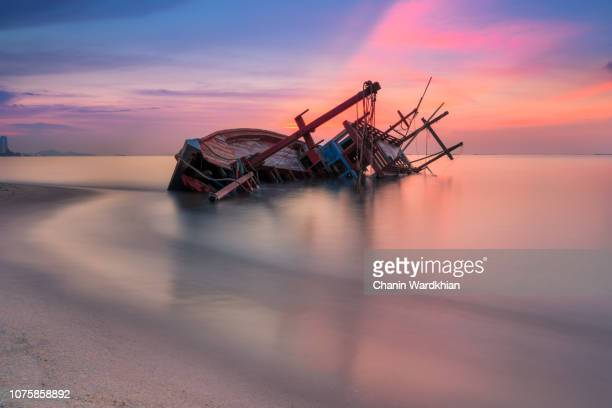 an old shipwreck or abandoned shipwreck - sunken stock pictures, royalty-free photos & images