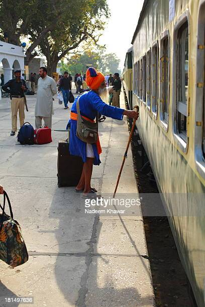 An Old Sikh yatri searching his reserved seat in train compartment at the Hasan Abdal Railway Station. As he came from India to attend the festival...