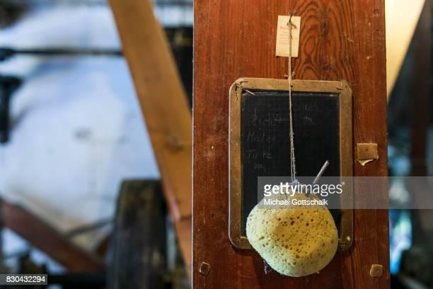 An old slateboard or blackboard with a sponge at Kanow mill Sagritz on August 09 2017 in Golssen Germany