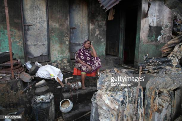 An old slum dweller sits in front of her burnt house which she built after years of struggle in Mirpur area of Dhaka 3000 families have been affected...