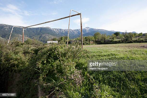 An old soccer goal post, mountains in background, Calacuccia, Corsica, France