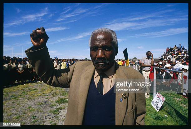 An old South African raises an arm at the funeral of nine people killed during the August 28 Gugulethu riots | Location Gugulethu South Africa