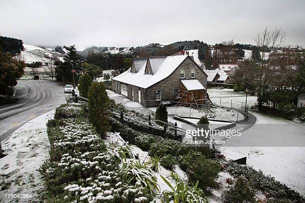 An old Stone House is covered in snow in Cracroft Valley on June 21 2013 in Christchurch New Zealand Now sleet rain and heavy winds have hit the...