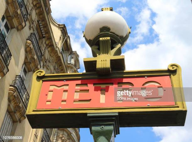 An old style sign of the Paris Metro