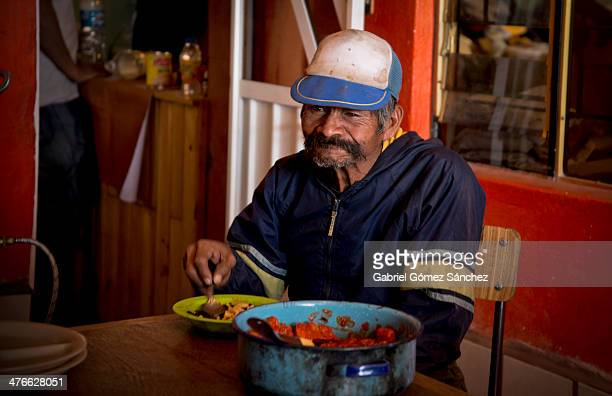 CONTENT] An old sudamerican migrant eating a cup of warm soup in the migrantrefugee in Huehuetoca Edo de México