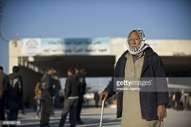 An old Syrian man who fled bombing in Aleppo, is seen as he waits at the Bab al-Salam crossing, opposite the Turkish province of Kilis, in Azaz town...