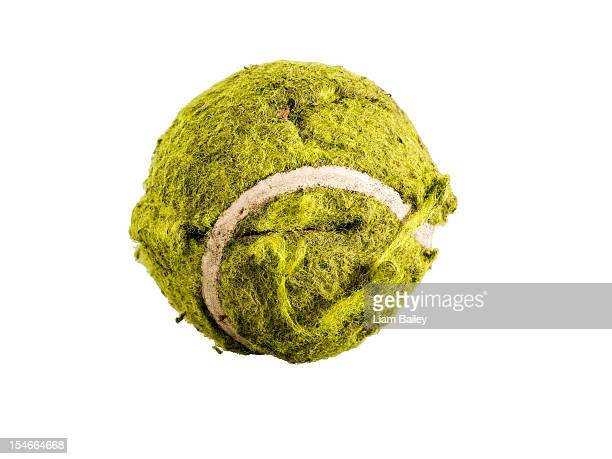 An old tennis ball, on a white background