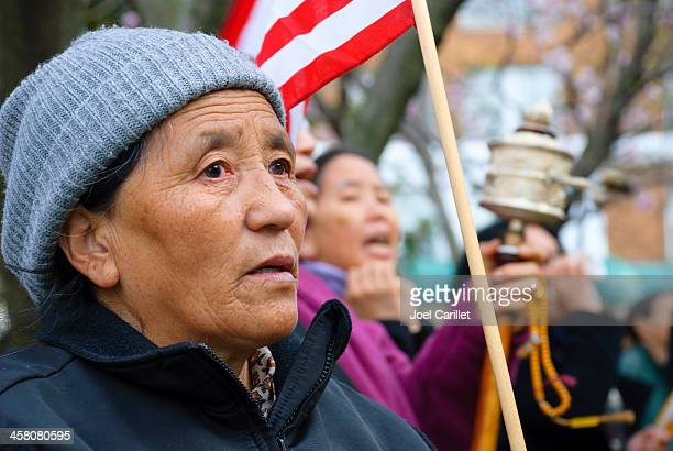 tibetan women protesting outside chinese embassy - human rights stock pictures, royalty-free photos & images