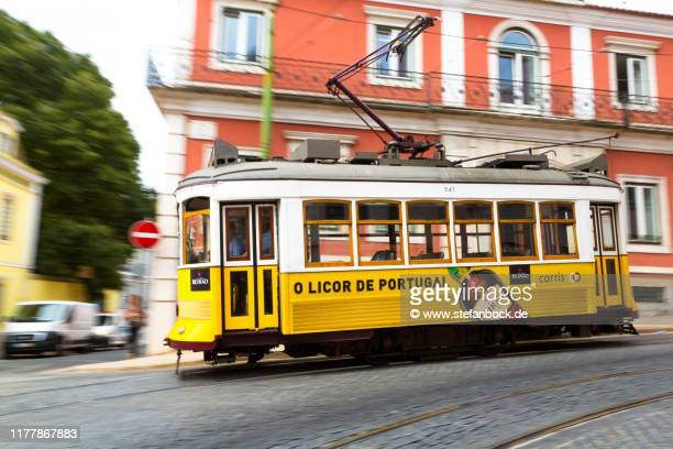 an old tram in lissabon in portugal - reise stock pictures, royalty-free photos & images