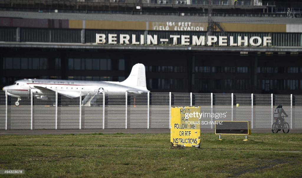 An old US cargo aircraft is seen in front of hangars of the