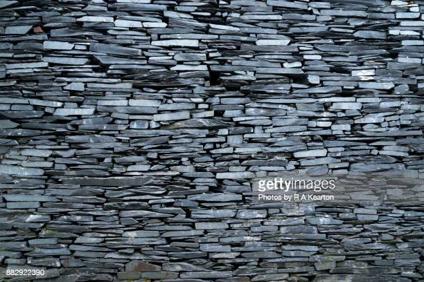 an old wall of welsh slate - stone wall stock pictures, royalty-free photos & images