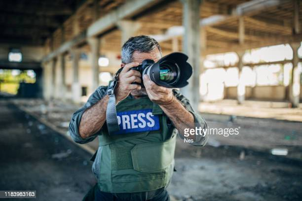 an old war journalist in action - war stock pictures, royalty-free photos & images