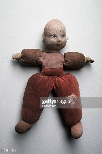 An old, weathered doll