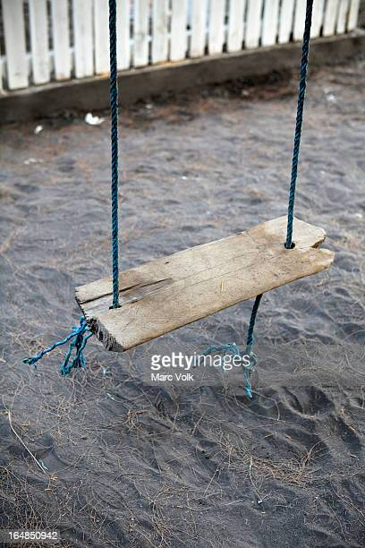 An old weathered wood swing, close-up, high angle view