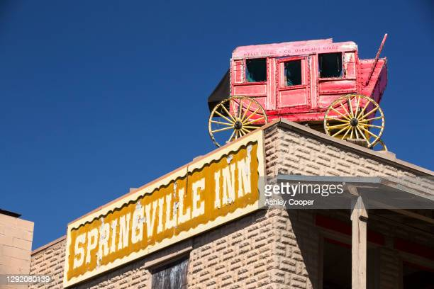 an old wells fargo mail wagon on the roof of the springvile inn, in sprinville, near porterville, california, usa. - springville california stock pictures, royalty-free photos & images