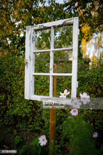 An old window stands as a decoration in a garden on October 17 2017 in Berlin Germany
