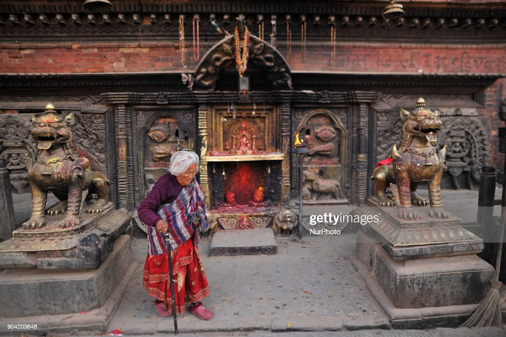 An old woman arrives to offer morning ritual prayer on Bhairab Temple at Bhaktapur, Nepal on Friday, January 12, 2018.