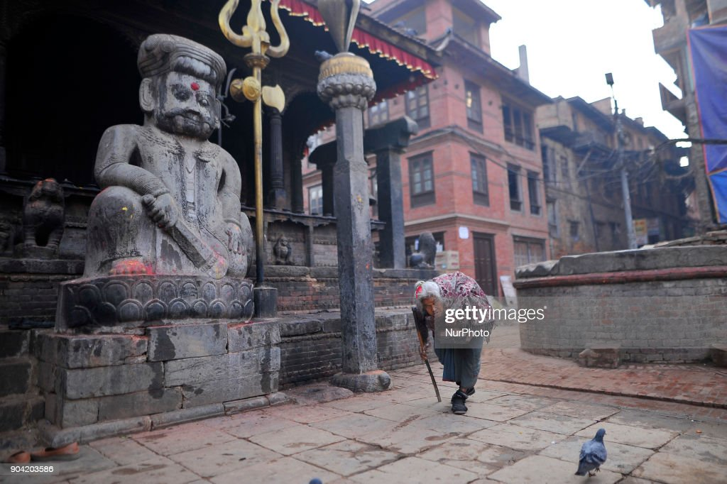 An old woman arrives to offer morning ritual prayer on Dattatreya Temple at Bhaktapur, Nepal on Friday, January 12, 2018.