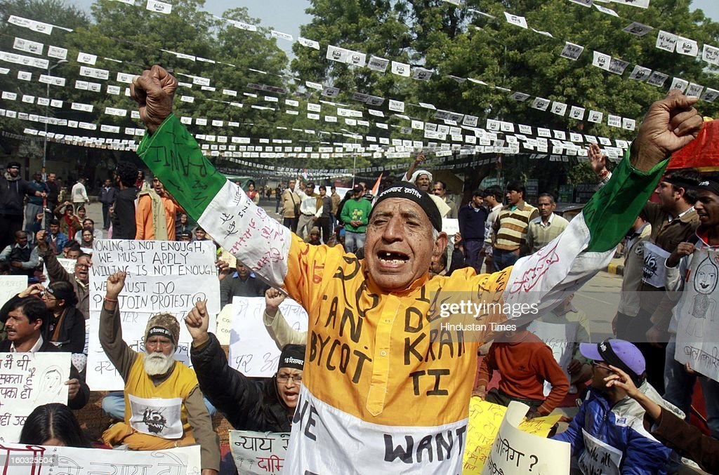 An old woman holds placards and shout slogans demanding the death penalty for six men accused of the fatal gang rape of a young woman last month during protest at Jantar Mantar on January 29, 2013 in New Delhi, India.