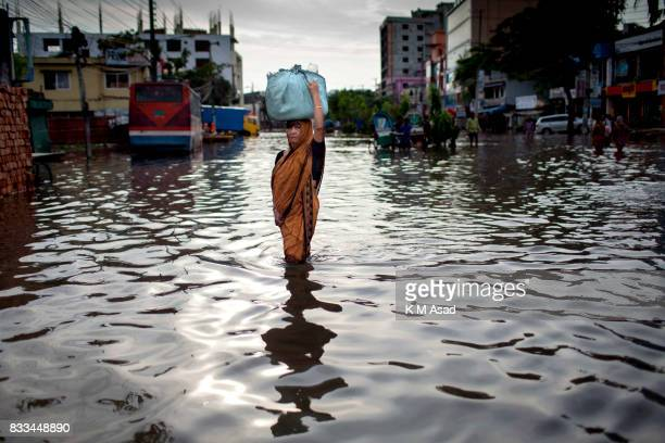 AGRABAD DHAKA CHITTAGONG BANGLADESH An old woman in a flooded area of Chittagong Chittagong city is facing unprecedented flooding this year due to...