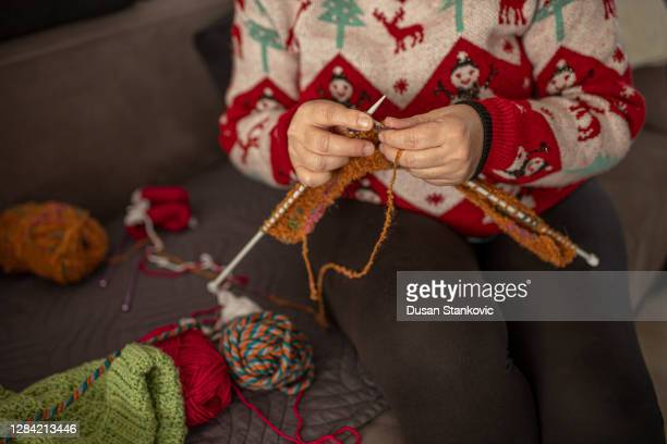 an old woman in sweater is knitting - old ugly woman stock pictures, royalty-free photos & images