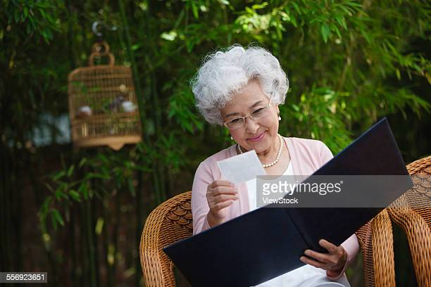 An old woman in the photos