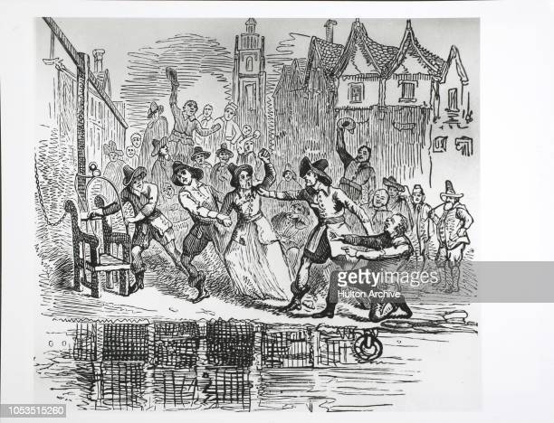 An old woman is dragged to the ducking stool at the river at Ipswich Suffolk The ducking stool was a chair in which people were restrained and ducked...