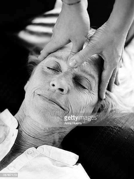 An old woman is getting massage in her face Sweden.